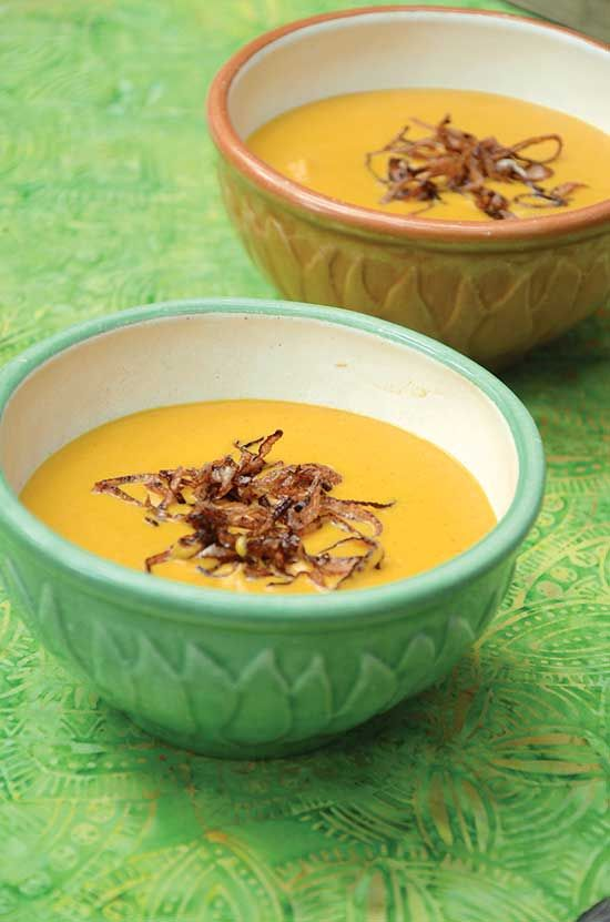 Heat up cold weather with this spicy sweet potato soup that includes crispy fried shallots as a topper.