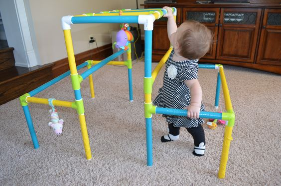 Our granddaughter playing on her jungle gym at 8 months old.
