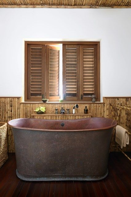 Bathroom. Discover a redesigned bamboo house on the Caribbean island of Mustique on HOUSE - design, food and travel by House & Garden.