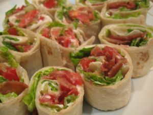 BLT Roll Ups! Ingredients 4 oz. Cream Cheese, softened. 1/4 cup mayo. 8 slices Bacon, cooked & crumbled. 1/2 cup chopped tomatoes. 2 tortillas (8 inch). 1/2 cup shredded romaine lettuce. Directions Mix cream cheese and mayo in medium bowl. Add bacon and tomatoes; mix well. Spread onto tortillas; top with lettuce. Roll up tightly. Cut each into 7 diagonal slices. Makes 14 Servings