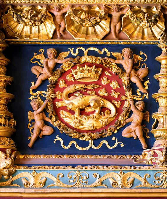 Heraldic fireplace detail at Château de Blois, featuring the badge of Francis I, King of France