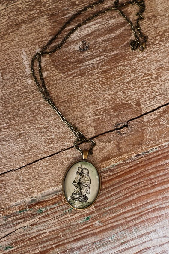 Bronze necklace, illustrated & hand painted designs.  www.etsy.com/shop/talisbrand