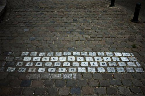 Keyboard on a sidewalk.