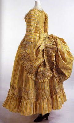 Yellow striped silk taffeta Robe à la polonaise, c.1780's Hooked closure at front; buttons to tack robe; matching petticoat. Following the trend toward simple clothing, women's costumes in the 1780s became more casual & fabrics used to make dresses had a light texture. ©The Kyoto Costume Institute, (KCI) photo by Takashi Hatakeyama: