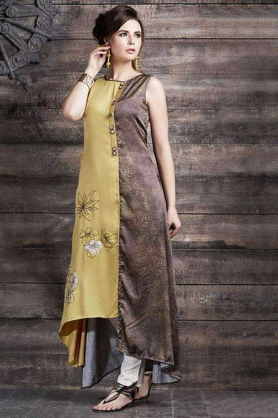 Exude sheer grace with this exotic two color kurti featuring a self printed brown satin panel on the left side going in an asymmetrical cut while the right side panel comes in a mustard yellow satin layer with brown resham embroidery outlines with white patch motifs. Placket comes in mustard satin with buttons for enhancement.