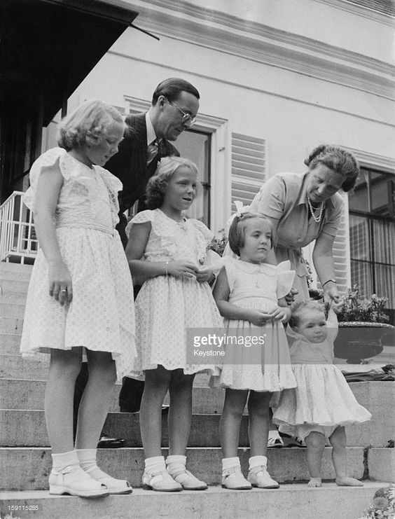 The Dutch royal family pose on the steps of Soestdijk Palace in the Netherlands, on the occasion of Princess Irene's 9th birthday, 5th August 1948. Princess Juliana (later Queen Juliana of the Netherlands) and her husband Prince Bernhard pose with their four daughters (left to right), Princess Beatrix (later Queen Beatrix of the Netherlands), Princess Irene, Princess Margriet and Princess Christina. (Photo by Keystone/Hulton Archive/Getty Images)
