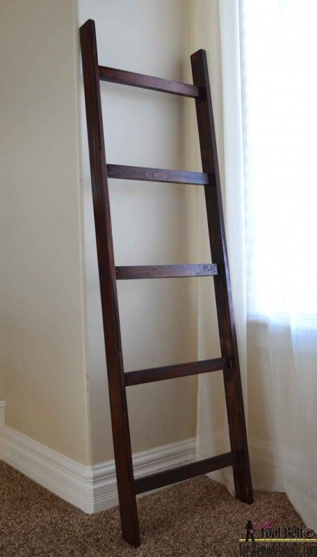 A blanket ladder is a great storage solution for bulky blankets and throws.  Build this easy DIY blanket ladder for about $5.