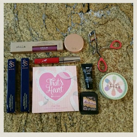 Makeup Bundle This bundle includes new as well as used makeup, you get everything pictured.  2 Stila Lipglosses (Citrine & Pink Sapphire, both new) 1 Coloupop Matte Lipstick (Creeper) 1 Tarte Deluxe Blush Sample (Enthused) 1 Stila Smudge Crayon (Pink Violet) 1 Stila Eyeshadow Trio (Rocky Road, new) 1 BH Cosmetics, That's Heart Palette (lightly used, but missing bronzer) 1 Deluxe Sample of the Rockateur Blush (3.0 g) 1 Deluxe Sample of They're Real Remover(7.5 mL, new) 1 Revlon Eyelash Curler…