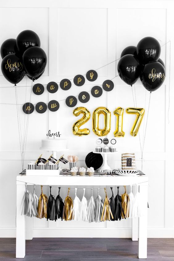 New Year's Eve party decor idea - Black, white + gold new year's party {Courtesy of The TomKat Studio}