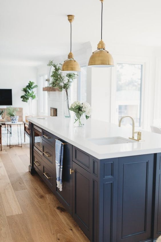 Beautiful kitchen with blue island cabinetry and brass pendant lighting over island - Andrea McQueen Design