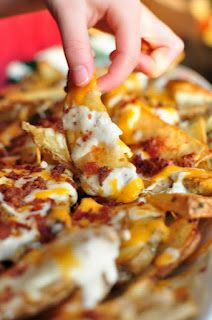"Great for Football season! Cheesy Potato Wedges... 4-6 Potatoes 1/4 c. Olive Oil Sea Salt, Pepper, your favorite Seasoning Salt 1 c. Sour Cream 1/2 c. Ranch Dressing 1/4 c. Milk 1 c. shredded Cheddar 1/2 c. shredded Mozzarella 1/2 c. Real Bacon Bits 1/4 c. Green Onions Cut potatoes into ""steak fries"". Place on foiled baking sheet. Drizzle with oil. Lightly toss with tongs. Sprinkle seasonings over the potatoes. Bake 400* for 40 min til fork tender."