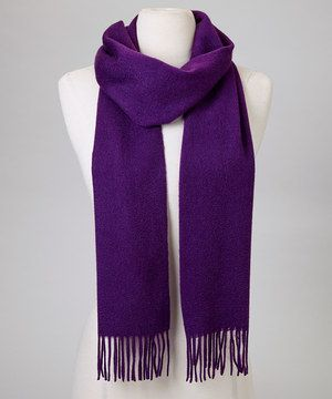 Delicate fringe and soft cashmere make this chic scarf an instant ensemble enhancer. Wrapped or looped, this solid-hue piece looks lovely in any setting.
