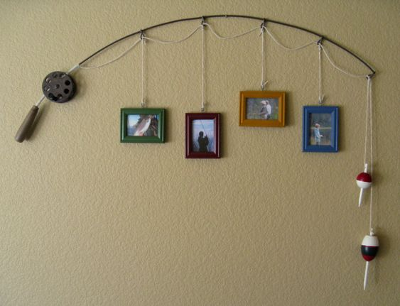 Old Fishing Pole...re-purposed into a unique & rustic picture hanging decoration for the wall.  Just attach assorted pictures by string on the pole and hang up.  Love the bobbers as decoration!!