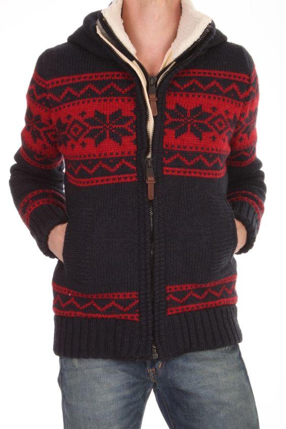 Dit Superdry Premium Knit Ski Puffer vest is gemaakt van een acryl,wol, nylon mix. De knaloranje voering is carré doorgestikt en is van katoen. Het vest heeft een capuchon en een aparte opstaande kraag.  Premium Knit Ski Puffer - MSKFK184