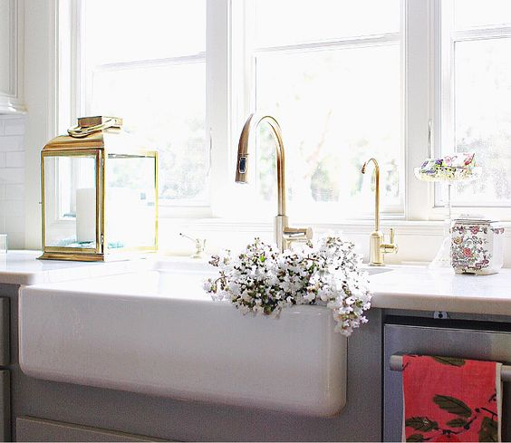 Kitchen faucet is Delta Trinsic in Champagne Bronze. Farmhouse sink is ...