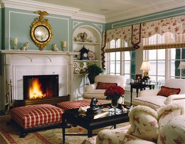 Living Room: Colonial - esque, Blue walls, white trim and paneling, excellent use of red, gold (love the mirror),