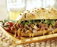 [southwestern shredded beef sandwiches] The beef and sauce mixture for this simple sandwich recipe is made  in your slow cooker. When the meat is ready, just add buns and dinner is ready.