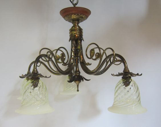 English close fitting five arm ceiling light in the original brass finish and of stylish design, complemented by replacement spiralled vaseline glass shades. www.antiquelightingcompany.com