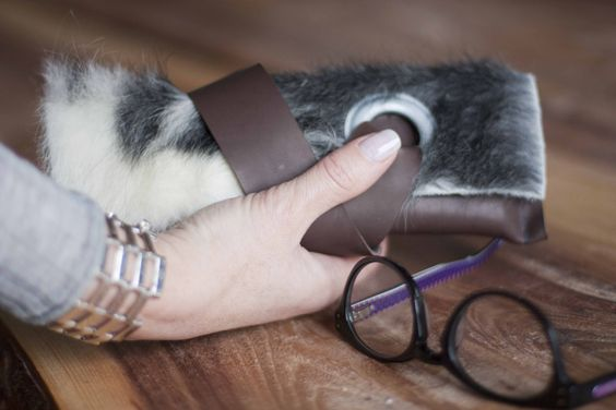 small clutch, glasses, leather and fur