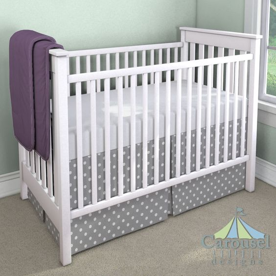 Crib bedding in Gray and White Polka Dot, Solid Aubergine Purple. Created using the Nursery Designer® by Carousel Designs where you mix and match from hundreds of fabrics to create your own unique baby bedding. #carouseldesigns