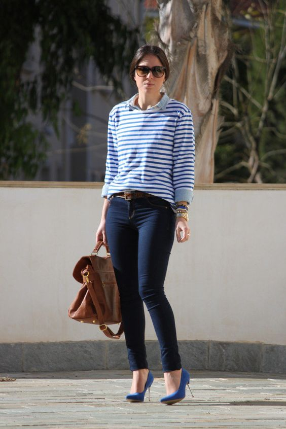 Preppy with a twist, thanks to a striped tee layered over a collared shirt and finished with polished pumps.