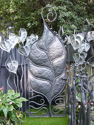 Garden gate by Bex Simon.  Combining leaves and doors...love!