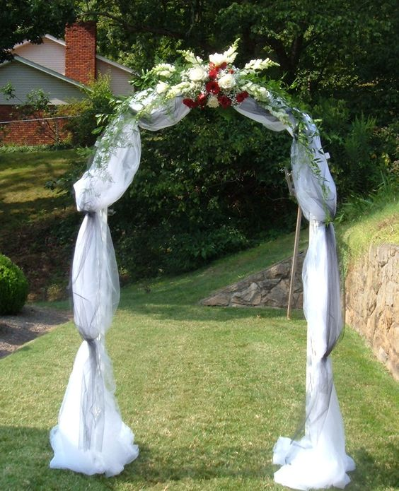Easy Diy Wedding Arch Ideas: Wedding Arch Covered With Tulle And Accented With Flowers