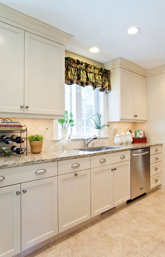 Santa cecilia granite countertops white kitchen cabinets for Kitchen renovations with white cabinets