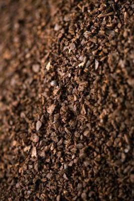 Used coffee grounds and eggshells are free and provide much-needed nutrients to the soil.