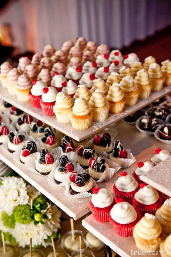 We love the idea of skipping a #weddingcake and going for a super cute, intricate cupcake display! #weddings
