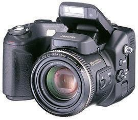 Fuji FinePix S7000 ,6MP, 6x zoom, 35-210mm, f/2.8-3.1 Inclusief geheugenkaart, batterijen, uv-filter/beschermlens, usb-kabel, draagriem, gebruiksaanwijzing. In originele verpakking.  Groothoeklens 0,79x met beschermkap