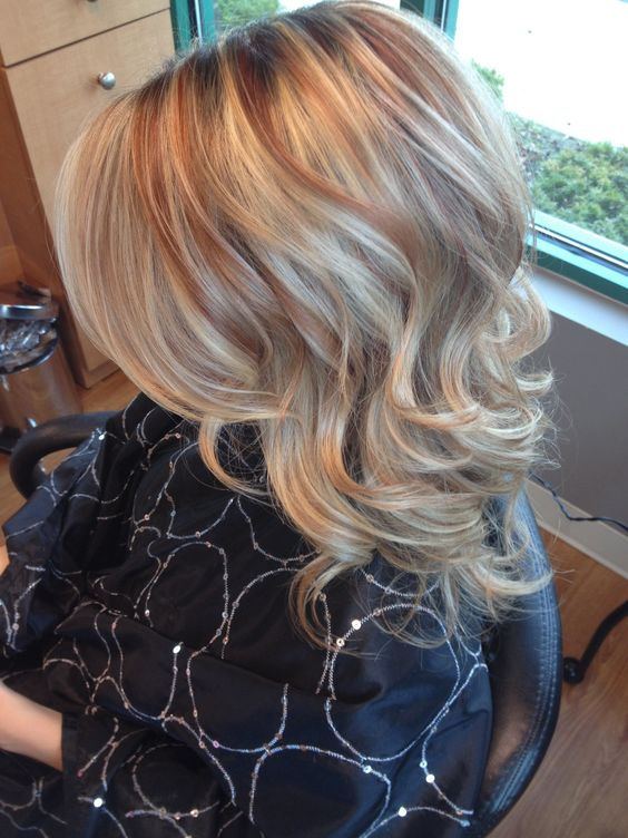 Blonde with copper highlights curls: