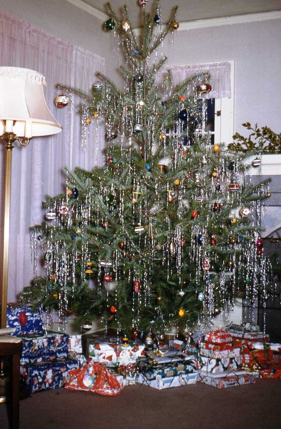 A Vintage 1950's Christmas tree. | I love trees dripping with silver tinsel...looks like icicles!