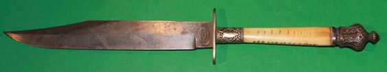 "Unusual Fancy BOWIE KNIFE, ca1960. Probably made in the UK using old knife factory parts. Oval stamp at ricasso reads: THOMAS BLAND - VOL. KNIFE- GEN.JACOB.PAT.. Blade 7 5/8"". Overall 13 1/4"". Fancy Ivory Blade with German Silver pommel and ferule."