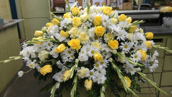 Casket flowers with roses, glads, daisy,, carnations