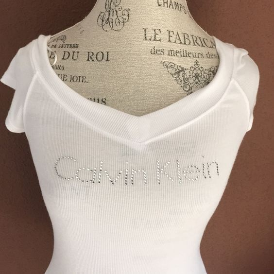 V neck t shirt Calvin Klein rhinestone V neck t shirt with cap sleeves. V in both front and back. Can be worn off the shoulder, as well!!  worn once!!!!  Calvin Klein Tops Tees - Short Sleeve