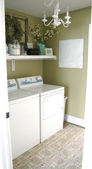 love the DIY shelf and all the decor above the washer and dryer....love the cute rug...and painted metal wall decor..now how to make my laundry room look more fresh...first..PAINT IT: