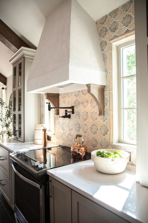 Fixer Upper Rustic Italian Kitchen. Detail of range, tile backsplash, and decorative range hood. #FrenchCountry #moderncountry #fixerupper #rangehood