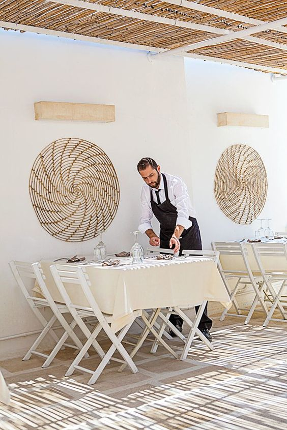 The sun-dappled terrace at Otranto's LaltroBaffo restaurant found on Italy's picturesque Salento Peninsula. | archdigest.com