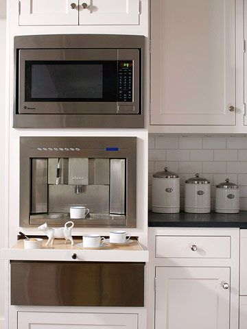 breakfast station with microwave, espresso machine, warming drawer and stacked cabinetry