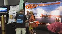 The PaddleAir team had a fun and busy time in our booth at The Boardroom surf show at the OC Fair & Event Center last weekend, October 5 and 6, 2013. Below is a fast video of the Sunday afternoon show actitivy put together by Ralph Chatillon. It features the guitar of Dano Forte and the camera sweeps the action of the booths, the boards, the shaping, and visitors.