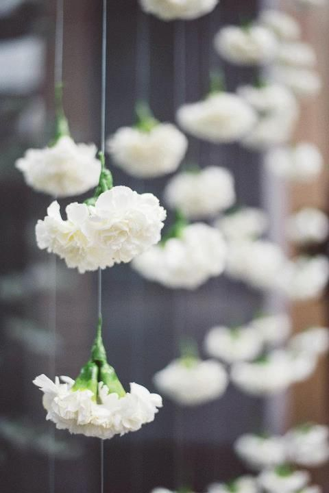 Fake flowers get a totally different look when hung from fishing line or wire…