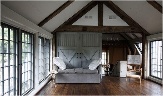 loft/studio, grey barn doorsTracery Interiors
