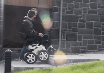 Toyota teamed up with the inventor of the Segway to build a prototype wheelchair that is able to climb stairs, hills and interact at eye level.
