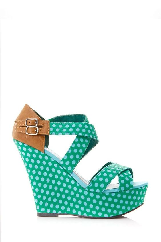 on a high platform shoes with polka dots with a leather belt back, fashion 2014