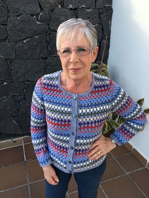 What do you get if you mix rainbow stripes and granny trebles? A jolly fab cardi by Fran Morgan. Team rainbow stripes with soft grey for a round-neck cardi with buckets of vintage charm. This treble-tastic design has playful contrasting buttons, too.