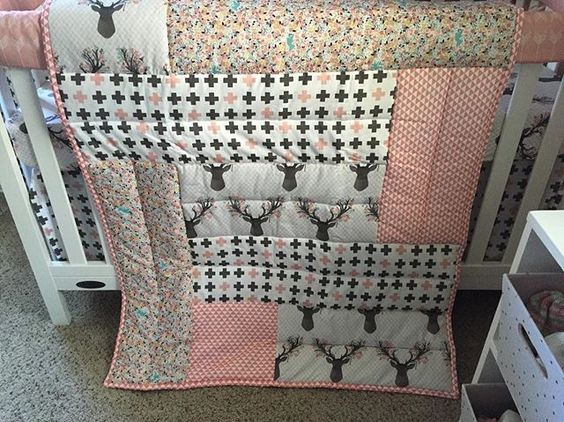 @littlemoosebyliza - Super excited to share a new product with you all! Our patchwork crib comforters! The pattern will be the same but you can choose any four fabrics from any collections, and either a solid or pattern back. This is a work of art and is a great way to pull together all the patterns of your nursery! This one is in my sweet Lila's nursery. #littlemoosebyliza #patchworkquilt #patchwork #nursery #nurserystyle #nurserydesign #babystyle