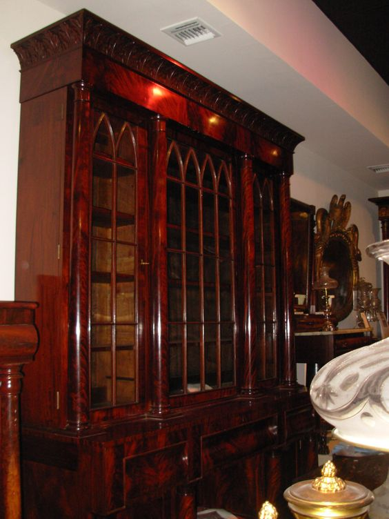 A monumental Philadelphia Mahogany Veneer Bookcase, Museum quality,French polished, with carved capitals, Gothic tracery on the glass doors & acanthus carved pediment. 9ft tall, 80 inches; long
