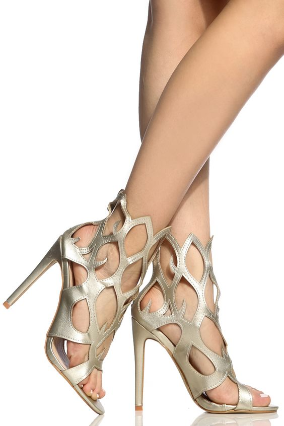 The perfect pair to add major edge to any look! It features a faux leather material, flame cut out detailing, open toe construction, rear zipper for closure, single soles and cushioned insoles. Wear this pair with your favorite midi body con and take on the night in major style!-True to size(Sizing may vary based on foot width)