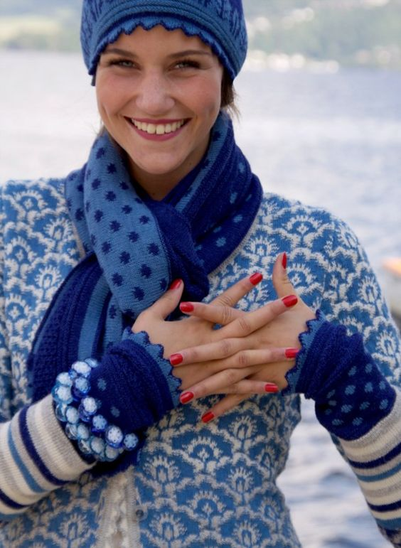 Oleana. Norwegian Knitting design. Never come to Norway without taking home a famous Norskie sweater with specialized embroidered ribbons and pewter buttons!